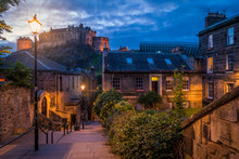 Scenic Sight In Edinburgh At Night With The Castle In The Background. Scotland.