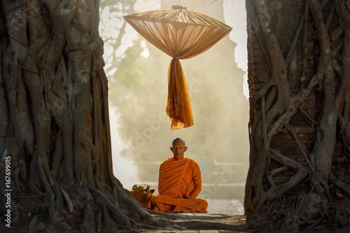 Buddhist monks are sitting samati on temple in mist sunset,Thailand Canvas Print