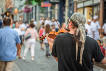 Street Musician Playing Violin Or Viola In Streets Of Old Quebec City