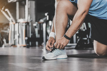 Man Arms Tying Shoelaces In Keep-fit Studio