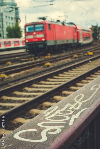 Blurred arrived red train und rails in front. Hamburg Poster
