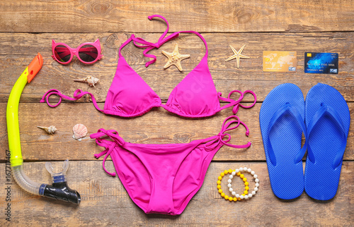 6a647ce714 Set of beach accessories on wooden background. Summer vacation concept