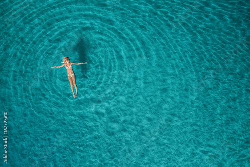 Valokuva Aerial view of swimming woman in Blue Lagoon