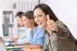Leinwandbild Motiv Proud worker with thumbs up at office