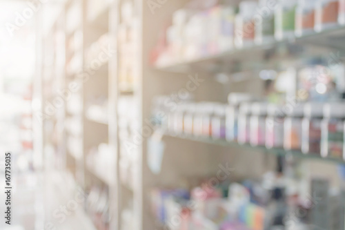 Photo sur Toile Pharmacie Pharmacy blur background with medicine on shelves