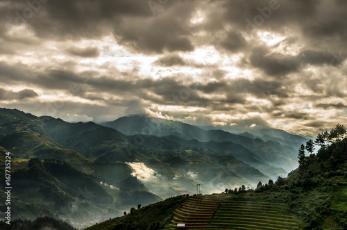 Photo sur Toile Montagne Rice fields on terraced of Mu Cang Chai District at sunrise time with sun ray, YenBai province, Northwest Vietnam, worm tone