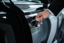 Close Up Of A Male Hand Closing A Car Door