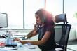 Leinwanddruck Bild - Businesswoman working at her desk in office.