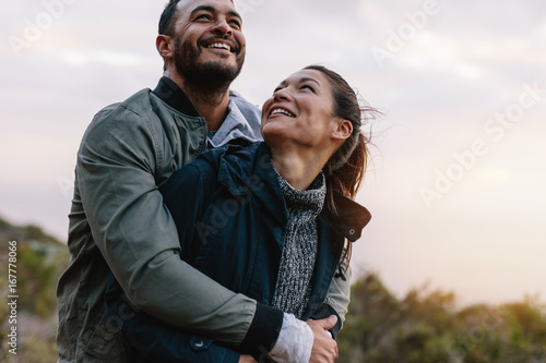 Romantic young couple embracing in nature