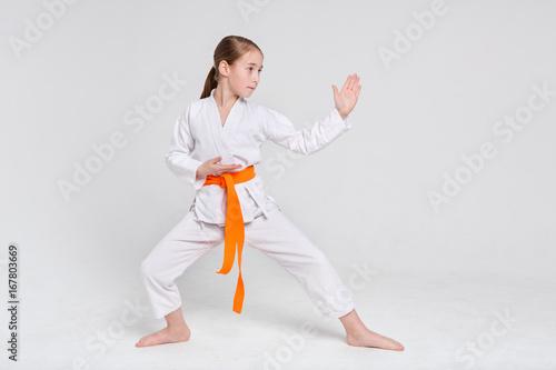Fotografía  Karate girl in kimono in stand at studio background