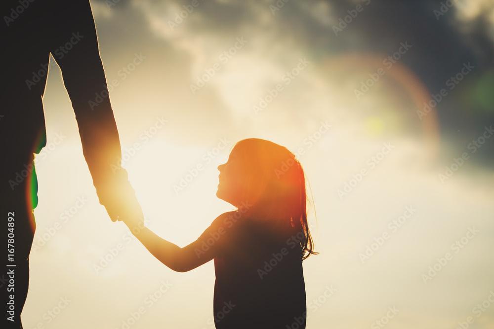 Fototapety, obrazy: silhouette of little girl holding parent hand at sunset