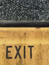EXIT On Car Door, Shattered Window Above