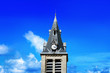 canvas print picture - Beautiful city tower with clock on blue sky background