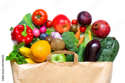 Fototapeta Full paper bag of different fruits and vegetables on a white background obraz na płótnie