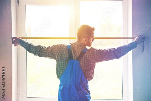 service man installing window with measure tape Tapéta, Fotótapéta
