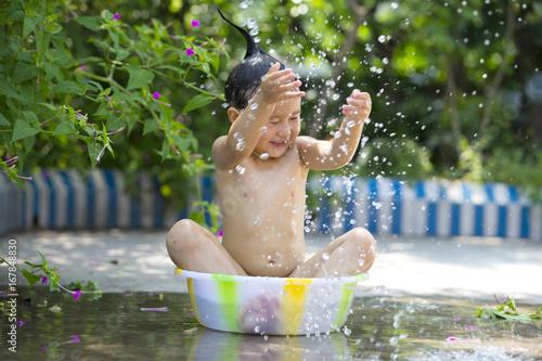 lovely little girl sitting in the basin