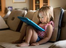 Preschool Girl Using A Tablet ...