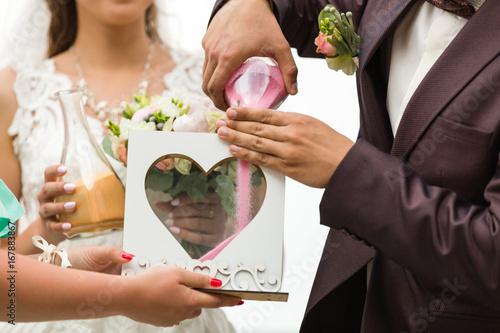 Fotografie, Obraz  Sand rite at wedding, Wedding rites