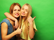 canvas print picture - Positive friends portrait of two happy  girls - funny faces, emo