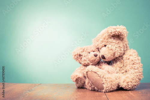 Teddy Bear toy mother with baby concept. Retro old style filtered photo