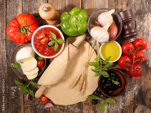 Foto op Canvas Pizzeria raw dough pizza and ingredients