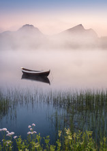 Very Peaceful Summer Night With Wooden Boat And Fog In Lofoten, Norway