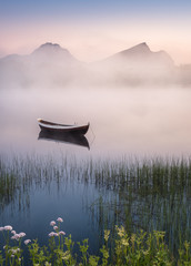 Fototapeta Mgła Very peaceful summer night with wooden boat and fog in Lofoten, Norway