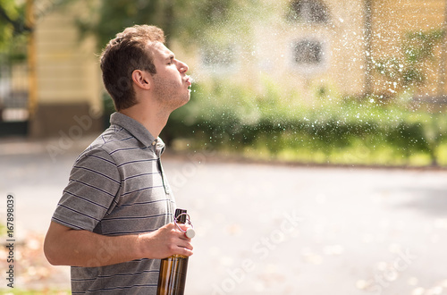 Young man spit out alcohol Canvas-taulu