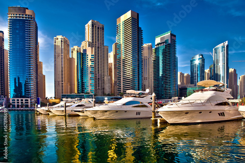 Dubai marina with luxury yachts in UAE