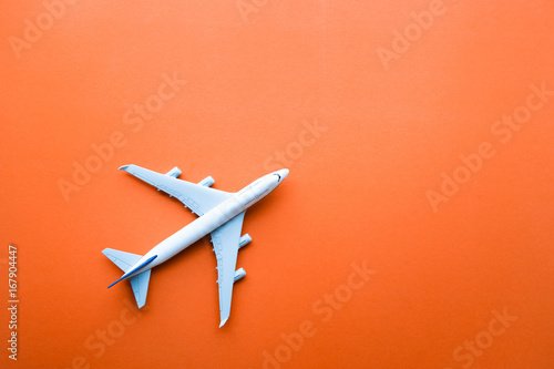Model plane,airplane on pastel color backgrounds.Flat lay design.