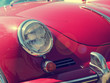 Vintage stylized summer background with an old red sports car