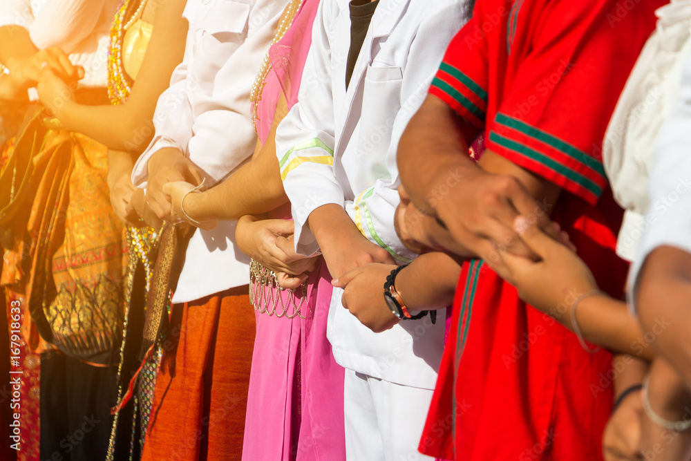 Fototapeta Symbol of diversity people shaking hands together for ASEAN Day