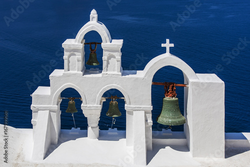Fototapeta Typical Greek white befry, Oia, Santorini, South Aegean, Greece