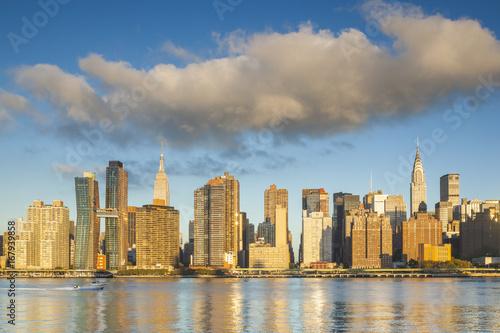 USA, New York, New York City, Long Island City, Mid town Manhattan skyline with Empire State Building, dawn