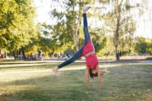 Young Girl Doing A Cartwheel O...