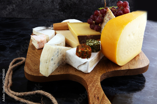 Fényképezés  Cheese platter with different cheese and grapes