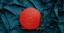 Red Vinyl On A Turntable