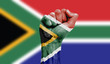 canvas print picture - South Africa flag painted on a clenched fist. Strength, Power, Protest concept