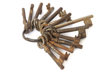 Bunch Of Old Rusty Keys On Whi...