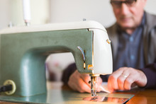 Senior Male Working On A Sewing Machine Indoor
