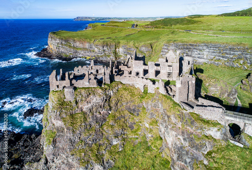 Fotobehang Rudnes Ruins of medieval Dunluce Castle, cliffs, bays and peninsulas. Northern coast of County Antrim, Northern Ireland, UK. Aerial view.