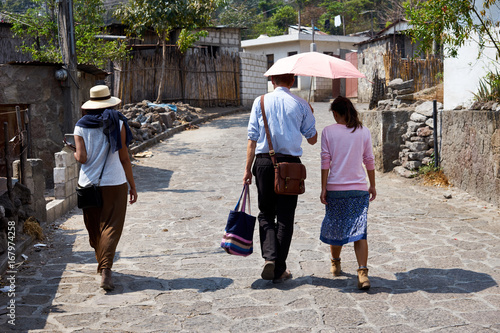 Valokuvatapetti Missionaries in Guatemala / Evangelizers of Holy Bible going from house to house
