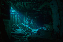 A Natural Light Shot Of The Inside Of The Shipwreck Of The Captain Keith Tibbetts In Little Cayman. The Inside Of This Room Is A Spooky Image As The Sun Lights Up A Small Section