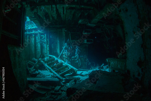 Acrylic Prints Shipwreck a natural light shot of the inside of the shipwreck of the captain keith tibbetts in little cayman. The inside of this room is a spooky image as the sun lights up a small section