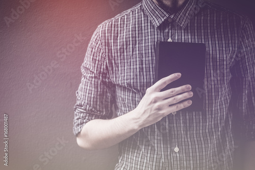Photo  Closeup on a man holding a bible at shopping mall, believe concept
