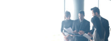 Blurred Business People In Office Interior With Space For Background Or Banner Design.