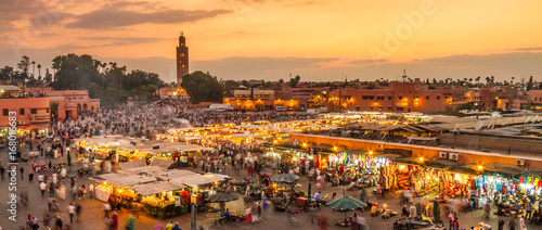 Spoed Fotobehang Afrika Jamaa el Fna market square, Marrakesh, Morocco, north Africa. Jemaa el-Fnaa, Djema el-Fna or Djemaa el-Fnaa is a famous square and market place in Marrakesh's medina quarter.