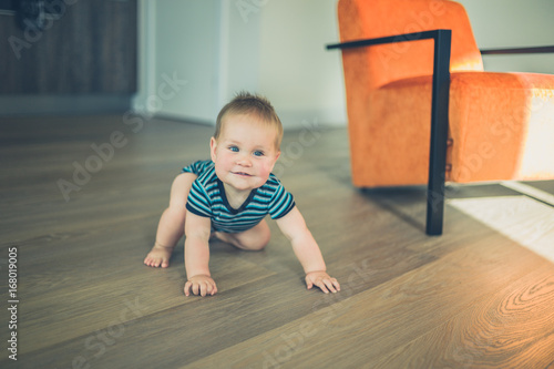 Cute little baby crawling in apartment Canvas Print