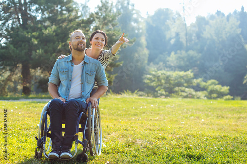 Fotografia, Obraz  Wife showing something in distance to her disabled husband