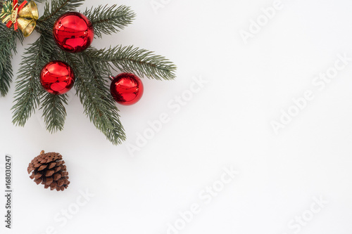 christmas and new year background fir tree and pine cone with decoration on white background